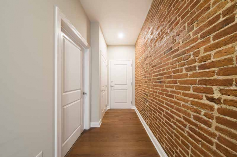 Historic touches include exposed brick walls