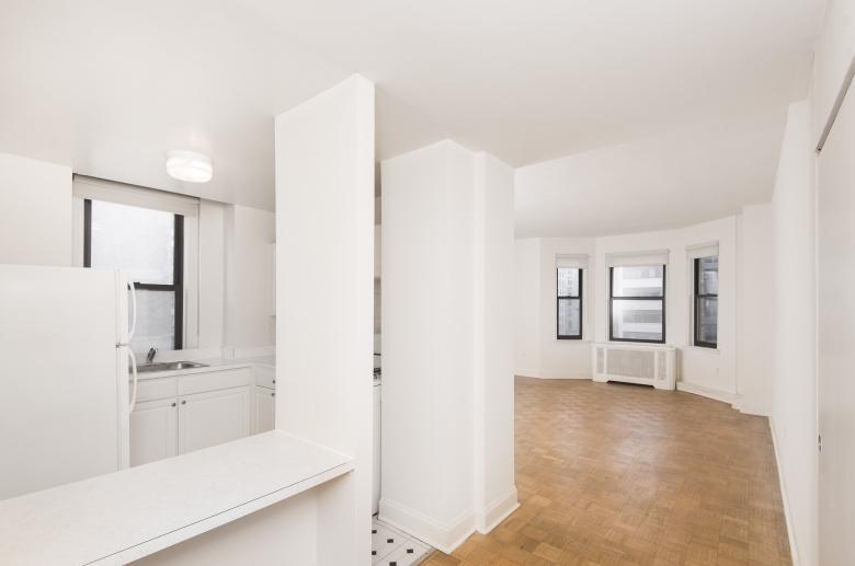 Hardwood flooring carries through living spaces