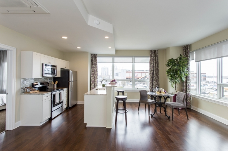 Open concept kitchen and dining areas at One Water Street