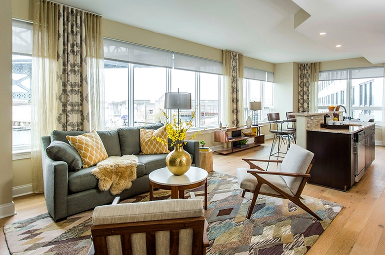 Open concept space with panoramic windows and stunning views of the city.