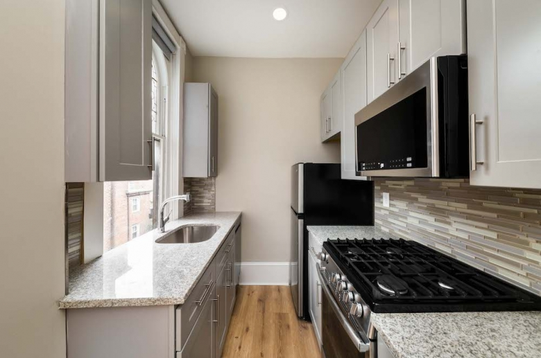 Galley kitchen with granite countertops
