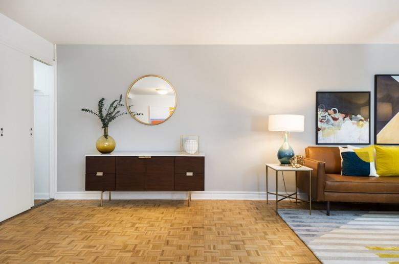Open concept living space with hardwood flooring