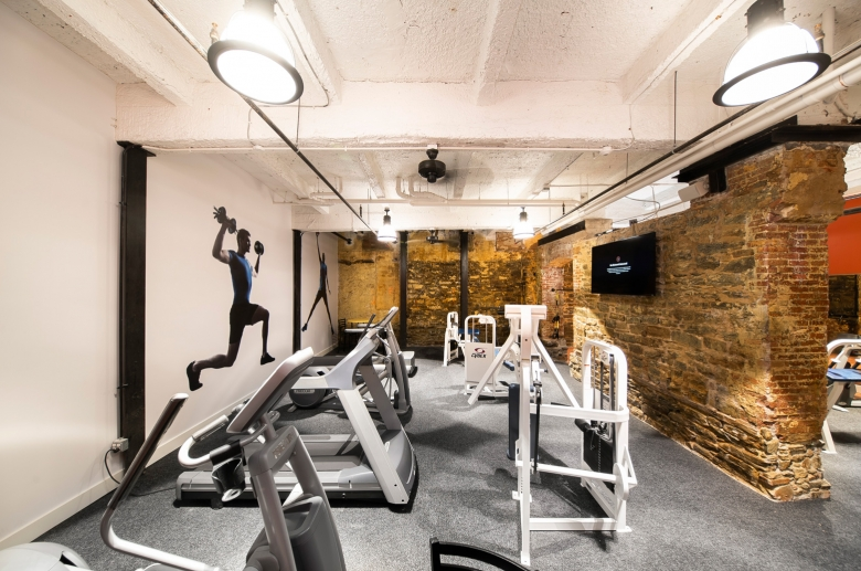 gym machinery with brick wall