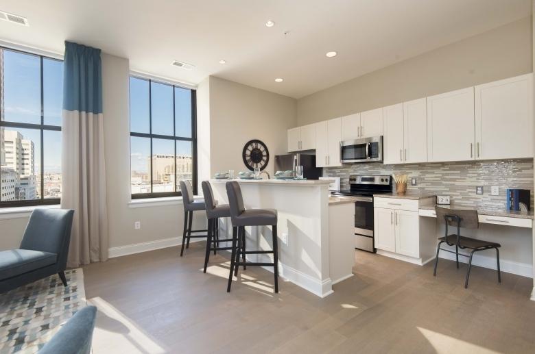 Kitchen featuring modern tile backsplash at One Water Street