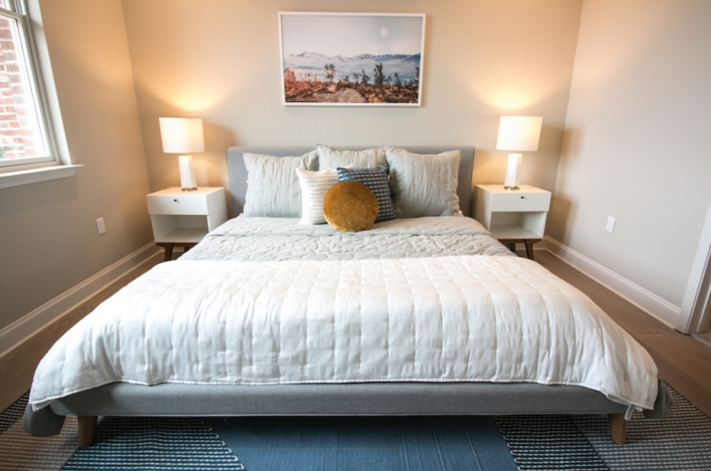 Room with king-sized bed at The Cottages at The Mills