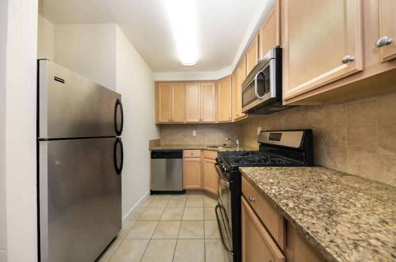 Fully equipped modern kitchens with granite countertops at 1634-38 Lombard Street
