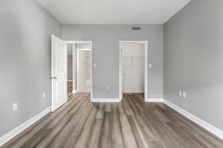 Bedroom with hardwood flooring