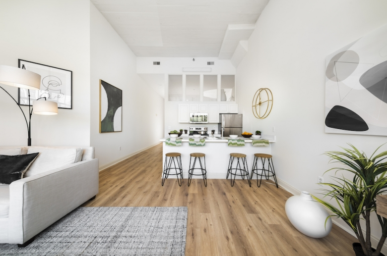 kitchen & living space with hardwood flooring