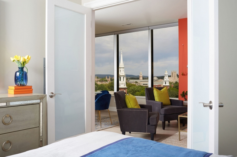 Extensive bedroom door that allows a view to the panoramic windows