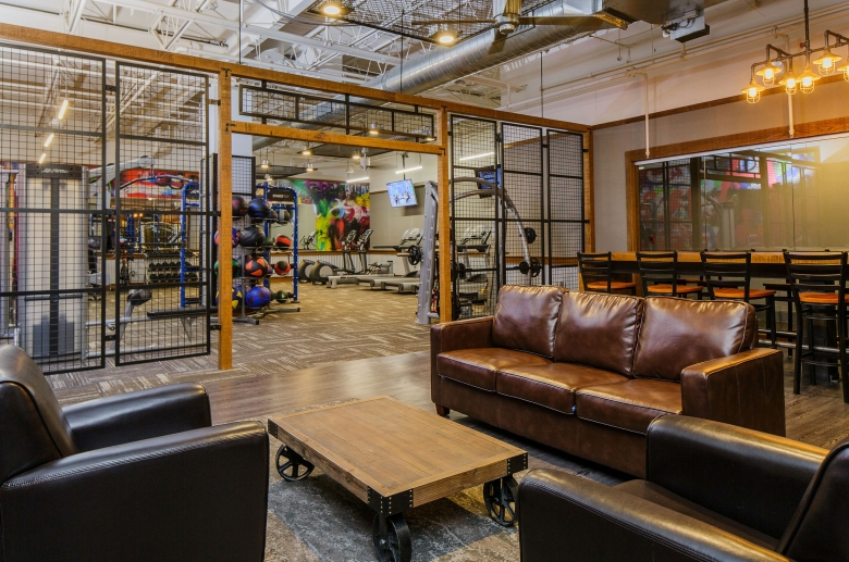 Resident's lounge featuring leather seating next to the gym