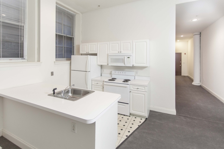 Kitchen at 1222 Arch Street featuring white appliances and cabinets