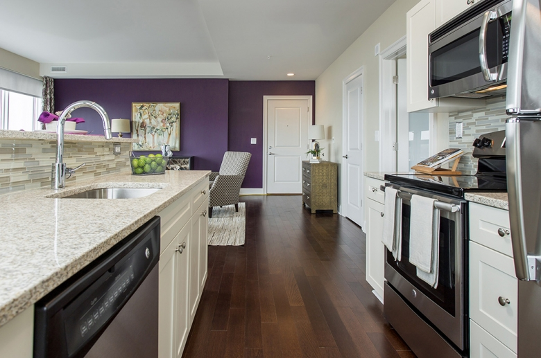 Open concept kitchen and living area at One Water Street