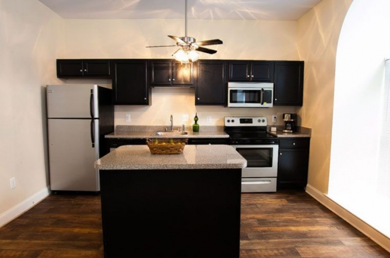 Renovated kitchen with ceiling fan