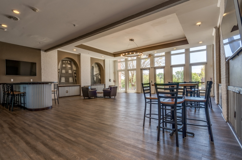 Lounge with floor-to-ceiling windows and stunning garden views at The Cottages at The Mills