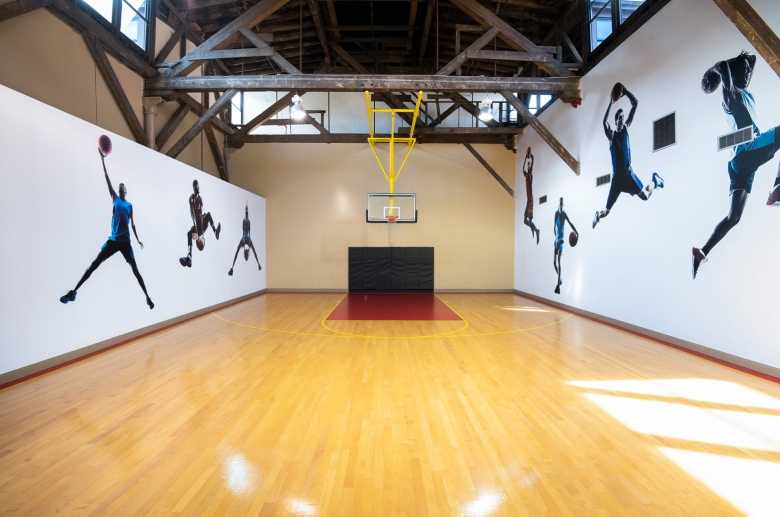 interior of gym with decorations of basketball players