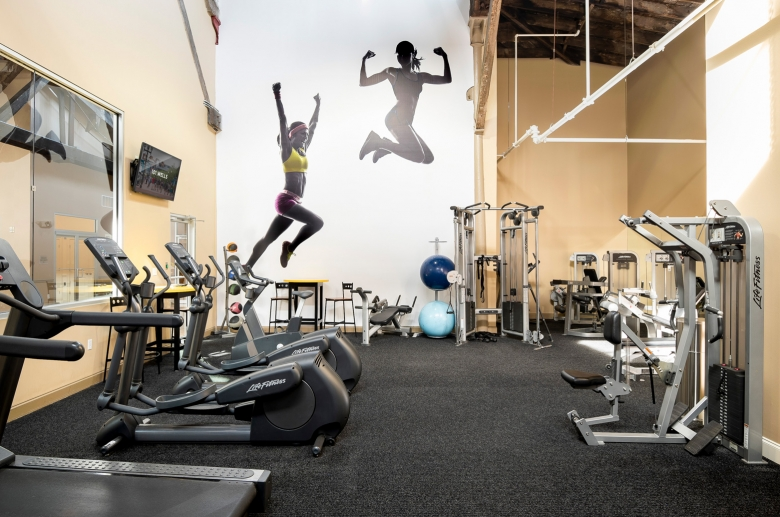 gym interior with machines and decorations of people working out