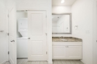 Updated modern bathroom with stackable washer and dryer