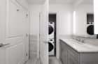 Bathroom with stackable laundry unit