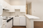 Kitchen featuring white cabinets, countertops, and appliances