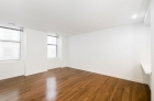 Dining space with gleaming hardwood floors