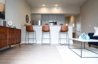 Living and barstool kitchen island seating