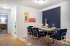 Dining space with wood flooring