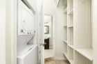 In-unit laundry space with built-in shelving