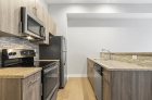 Steel appliances and granite countertops at 1300 Chestnut Street kitchen