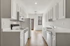 Kitchen featuring white cabinets and appliances