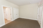 Bedroom with wall to wall carpeting
