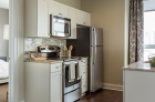 One Water Street kitchen featuring stainless steel appliances and granite countertops.